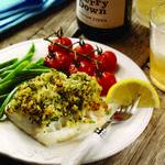Запеченное на овощной подушке рыбное филе