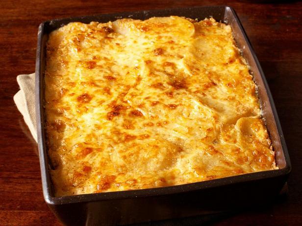 Фотография блюда - Запеченный картофель с сыром и сливками