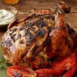 Курица с зеленью и помидорами в духовке