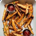 Картофельные дольки по-деревенски в духовке